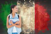 Student holding tablet pc against italy flag — Stock Photo