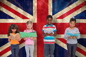 Pupils reading against union jack flag — Stock Photo
