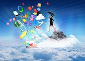 Young businesswoman holding umbrella — Stockfoto