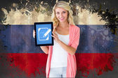 Student showing tablet against  dutch flag — Stock Photo
