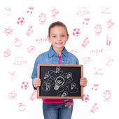 Söt elev visar svarta tavlan — Stockfoto