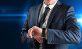 Businessman checking the time — Stock Photo