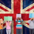 Постер, плакат: Pupils reading against union jack flag