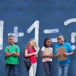 Постер, плакат: Pupils against chalkboard with math question
