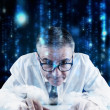 Focused businessman against blurred letters — Stock Photo #51560963
