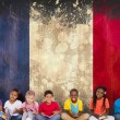 Постер, плакат: Pupils reading books against france flag