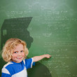 Composite image of cute pupil with graduate outline — Stock Photo #51561285