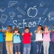 Постер, плакат: Pupils showing thumbs up against chalkboard
