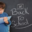 Boy using tablet against back to school message — Stock Photo #51561705