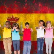 Elementary pupils against spain flag — Stock Photo #51563083