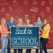 Group of people holding blackboard — Stock Photo #51563609