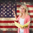 Student reading against usa flag — Stock Photo #51565049