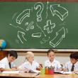 Arrows and math signs against pupils — Stock Photo #51565217