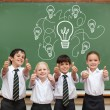 Idea and innovation graphic against pupils — Stock Photo #51565365