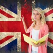Student pointing against union jack flag — Stock Photo #51565837