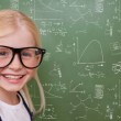 Composite image of cute pupil smiling — Stock Photo #51566095