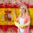 Student pointing against spain flag — Stock Photo #51567005