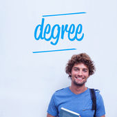 Degree against happy student holding book — Stok fotoğraf