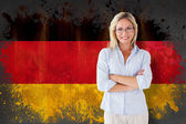 Student smiling against germany flag — Stock Photo