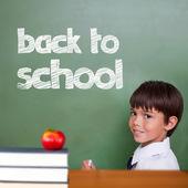 Cute pupil holding chalk — Stock Photo