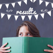Results against student holding book — Stock Photo