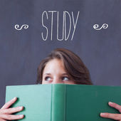 Study against student holding book — Stockfoto