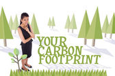 Thoughtful businesswoman against forest — Stock Photo