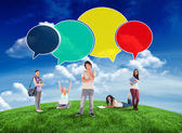 Happy students with speech bubbles — Stock Photo