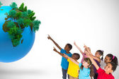 Pupils pointing with vignette with globe — Stock Photo