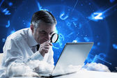 Businessman examining with magnifying — Stock Photo