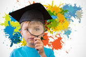 Pupil looking through magnifying glass — Stock Photo