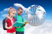 Cute pupils reading against globe — Stock Photo