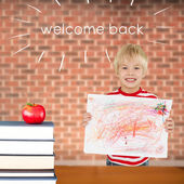 Welcome back against red apple on pile of books — Stock Photo