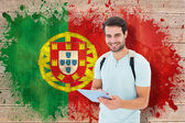 Student using tablet against portugal flag — Stok fotoğraf