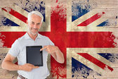 Student showing tablet against union jack flag — Stock Photo