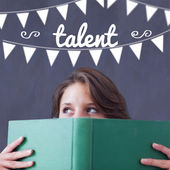 Talent against student holding book — Stock Photo