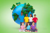 Pupils against green vignette with globe — Stock Photo