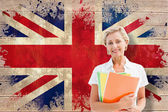 Student smiling against union jack flag — Stock Photo