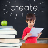 Create against green apple on pile of books in classroom — Stock Photo