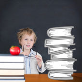 Learn against red apple on pile of books — Stok fotoğraf