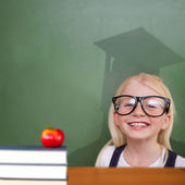 Pupil with graduate shadow in classroom — Stock Photo