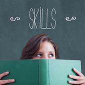 Skills against student holding book — Stock Photo