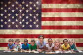 Pupils with teacher against usa flag — Stock Photo