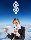 Redhead businesswoman using her tablet pc — Stock Photo