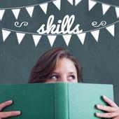 Skills against student holding book — Stockfoto