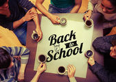 People drinking coffee against back to school — Stock Photo