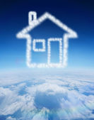 Cloud in shape of house — Stock Photo
