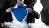 Businessman opening his shirt superhero — Stock Photo
