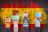 Pupils reading against spain flag — Stock Photo