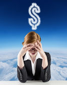 Redhead businesswoman with head in hands — Stock Photo